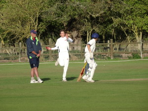 Action: Sam Carding (bowler), Joey Greenslade (batsman) & Chris Brook (umpire)