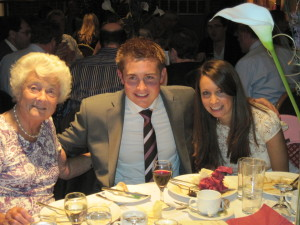 Audrey at the 2009 Dinner with grandchildren Olly & Lucy.
