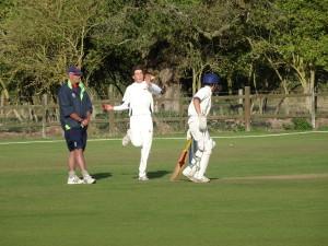Action: Sam Carding (bowler), Joey Greenslade (batsman) & Chris Brook (umpire)