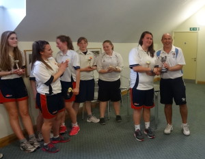 Kevin Denmark presents the Cup to Captain Emily Reay.